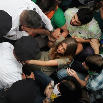 Police arrest demonstrators affiliated with the Occupy Wall Street movement after they attempted to cross the Brooklyn Bridge on the motorway on October 1, 2011 New York City. The highway is not intended for pedestrians, the marchers attempted to cross the bridge on the highway and were stopped on the middle of the bridge by police. Police were in the process of arresting hundreds of the protesters on the bridge. Occupy Wall Street demonstrators are opposed to outsized corporate profits on Wall Street.