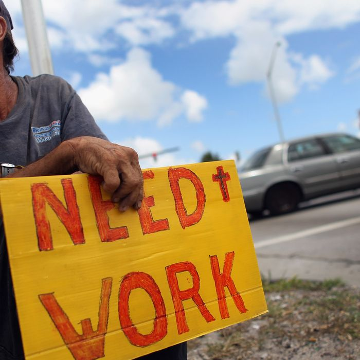 POMPANO BEACH, FL - JUNE 03: Stephen Greene works a street corner hoping to land a job as a laborer or carpenter on June 3, 2011 in Pompano Beach, Florida. Employers in May added 54,000 jobs, the fewest in eight months, and the unemployment rate inched up to 9.1 percent. (Photo by Joe Raedle/Getty Images)