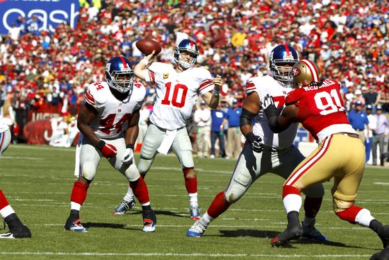 Quarterback Eli Manning #10 of the New York Giants throws a pass for a touchdown to Victor Cruz #80 (not pictured) during the second quarter against the San Francisco 49ers at Candlestick Park on October 14, 2012 in San Francisco, California.