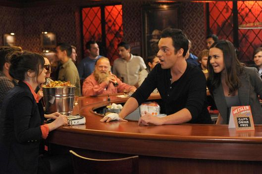 "NEW GIRL:  Jess (Zooey Deschanel, L) visits Nick (Jake Johnson, C) during his big marketing campaign to promote the bar and meets his beautiful boss (guest star Odette Annable, R) in the ""Guys Night"" episode of NEW GIRL airing Tuesday, March 12 (9:00-9:30 PM ET/PT) on FOX."