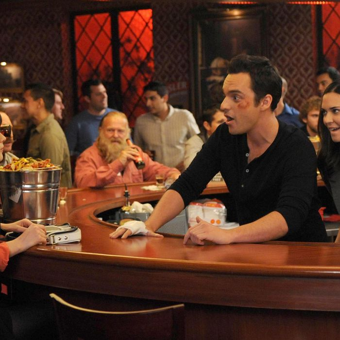 NEW GIRL: Jess (Zooey Deschanel, L) visits Nick (Jake Johnson, C) during his big marketing campaign to promote the bar and meets his beautiful boss (guest star Odette Annable, R) in the
