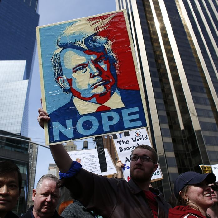 People rally as they take part in a protest against Republican presidential front-runner Donald Trump in New York on March 19,2016.