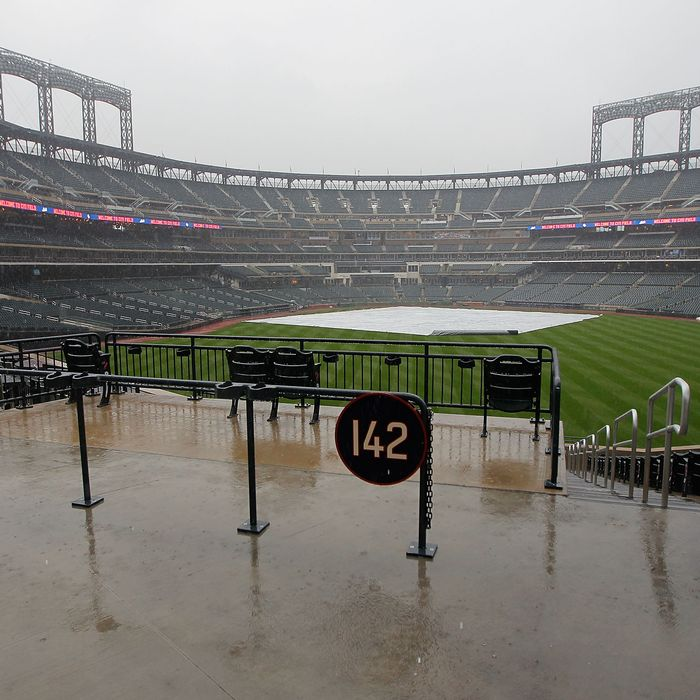 NEW YORK, NY - AUGUST 09: The field is covered as the rain comes down preventing the teams from taking batting practice before the start of a Major League Baseball game between the New York Mets and the San Diego Padres at Citi Field on August 9, 2011 in the Flushing neighborhood of the Queens borough of New York City. (Photo by Paul Bereswill/Getty Images)