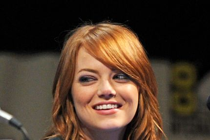 "SAN DIEGO, CA - JULY 22:  Actress Emma Stone speaks at ""The Amazing Spider-Man"" Panel  during Comic-Con 2011 at San Diego Convetion Center on July 22, 2011 in San Diego, California.  (Photo by Kevin Winter/Getty Images)"