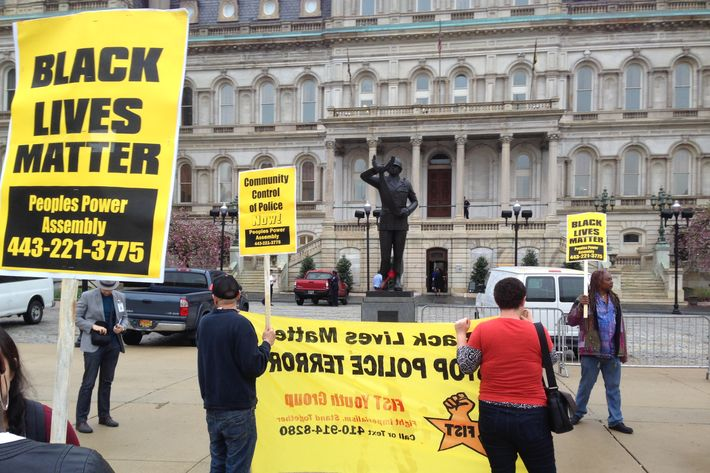 Demonstrators protest the death of Freddie Gray outside Baltimore City Hall on Monday, April 20, 2015. Gray died Sunday, a week after he was rushed to the hospital with spinal injuries following an encounter with four Baltimore police officers. (AP Photo/David Dishneau)