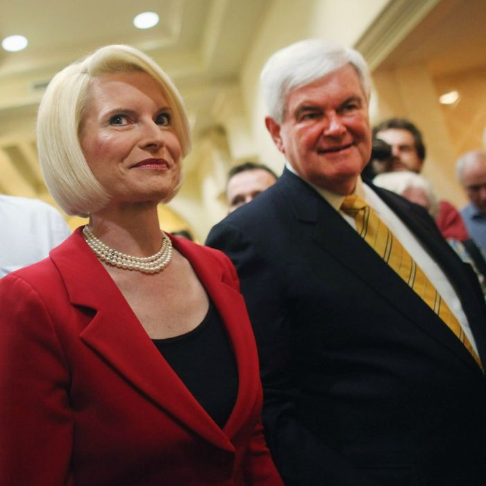 NAPLES, FL - NOVEMBER 25: Republican presidential hopeful and former Speaker of the House Newt Gingrich (R) and his wife Callista enter a Hilton Hotel on November 25, 2011 in Naples, Florida. Gingrich discussed foreign policy issues and restated his position on illegal immigrants in the United States. Gingrich, who has rose in recent polls following strong debate performances, had been written off earlier this year and is now expected to do well in the Iowa caucuses in early January. (Photo by Spencer Platt/Getty Images)