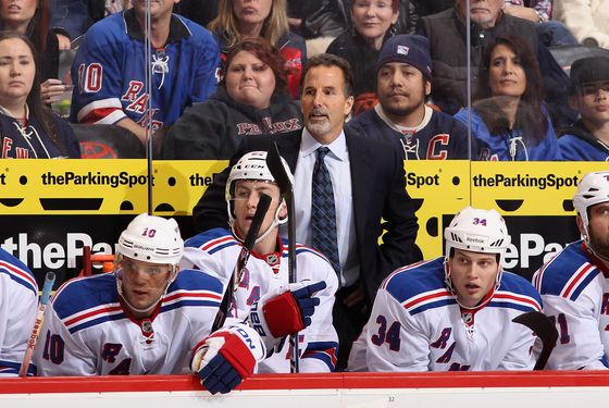 Head coach John Tortorella of the New York Rangers watches from the bench during the NHL game against the Phoenix Coyotes.