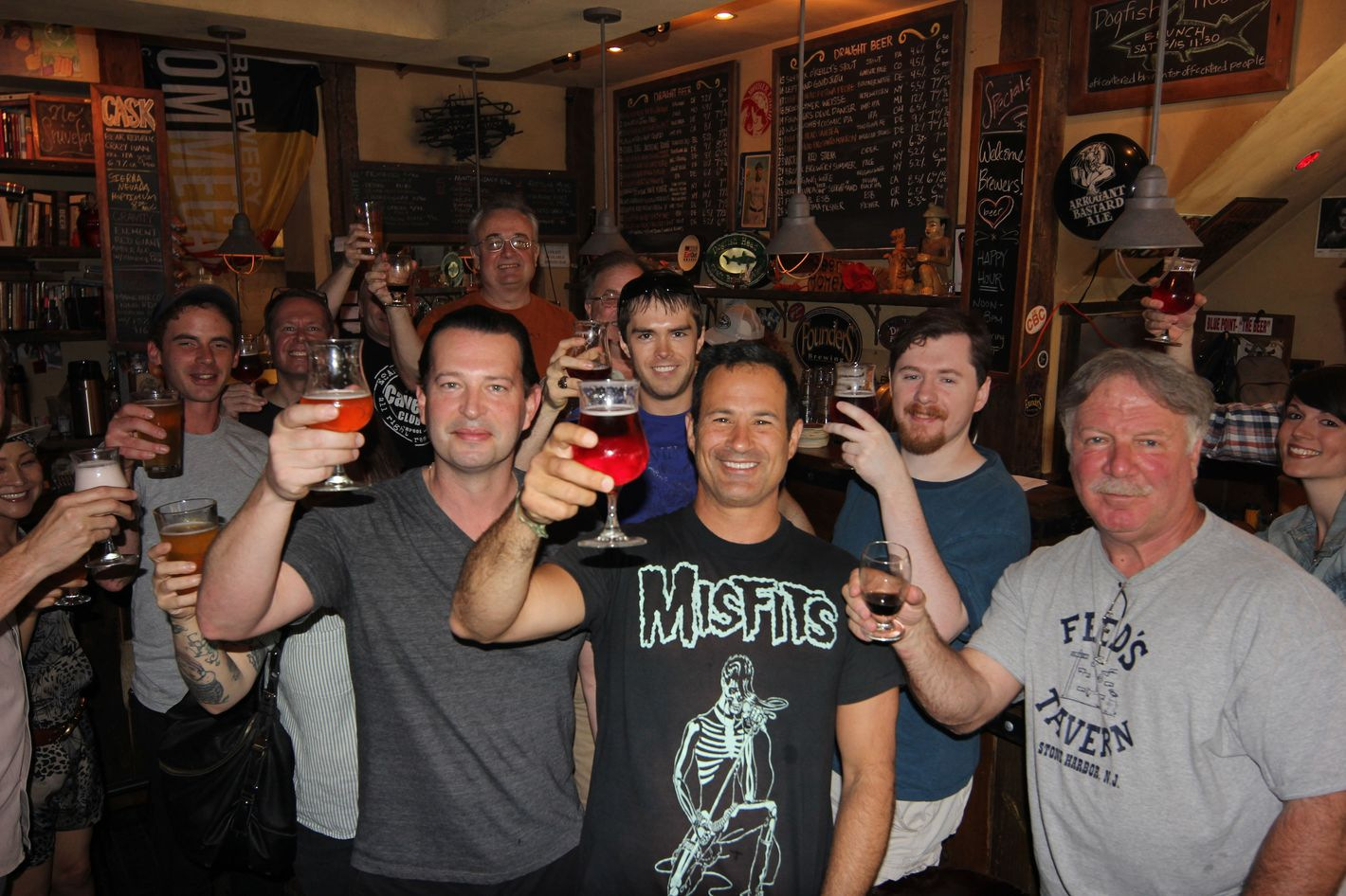 Calagione (in the Misfits shirt) with some friends at the Blind Tiger.