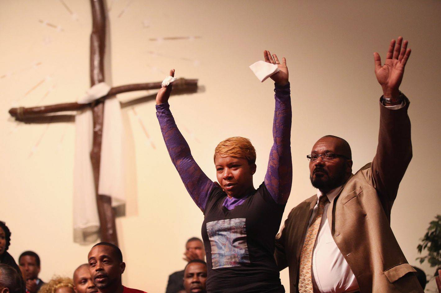 ST. LOUIS, MO - AUGUST 12:  Lesley McSpadden (L), the mother of slain teenager Michael Brown joins a capacity crowd of guests at Greater St. Marks Family Church to discuss the killing of her son and the civil unrest resulting from his death on August 12, 2014 in St Louis, Missouri. Brown was shot and killed by a police officer on Saturday in the nearby suburb of Ferguson. Ferguson has experienced two days of violent protests since the killing but, tonight the town remained mostly peaceful.  (Photo by Scott Olson/Getty Images)