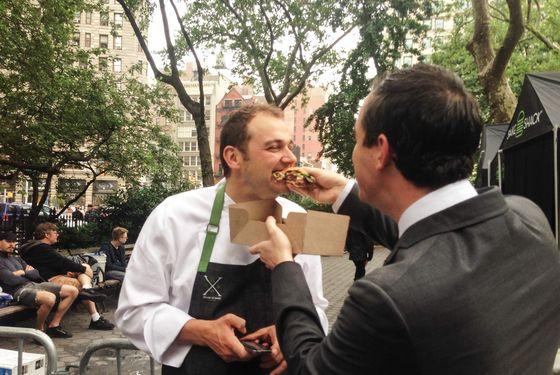 Will Guidara feeds Daniel Humm his record-breaking Shake Shack burger.