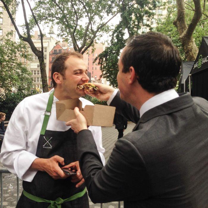Guidara feeds Humm a Humm-burger.
