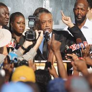 SANFORD, FL - MARCH 22:   Rev. Al Sharpton (C) speaks at a rally with Tracy Martin (R), and Sybrina Fulton (2nd L), parents of slain teenager Trayvon Martin, on March 22, 2012 in Sanford, Florida. Sanford Police Department Chief Bill Lee announced today he will temporarily step down following the killing of the black unarmed teenager by a white and Hispanic neighborhood watch captain. Sharpton organized today's rally.  (Photo by Mario Tama/Getty Images)