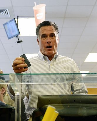US presidential hopeful Mitt Romney pays for a sandwich as he visits a WaWa gas station in Quakertown, Pennsylvania, June 16, 2012.