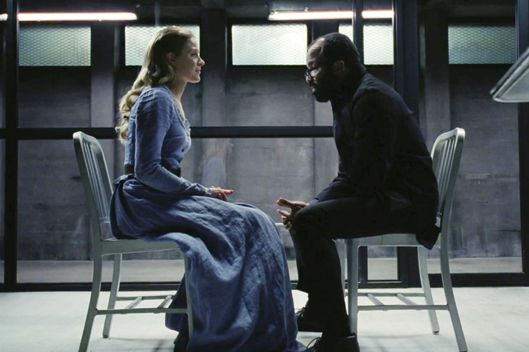 Evan Rachel Wood as Dolores, Jeffrey Wright as Arnold.