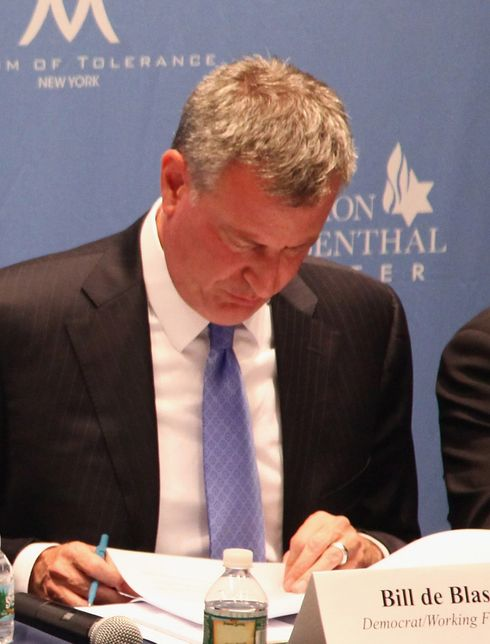 Bill de Blasio either sleeping or just looking down for one second.