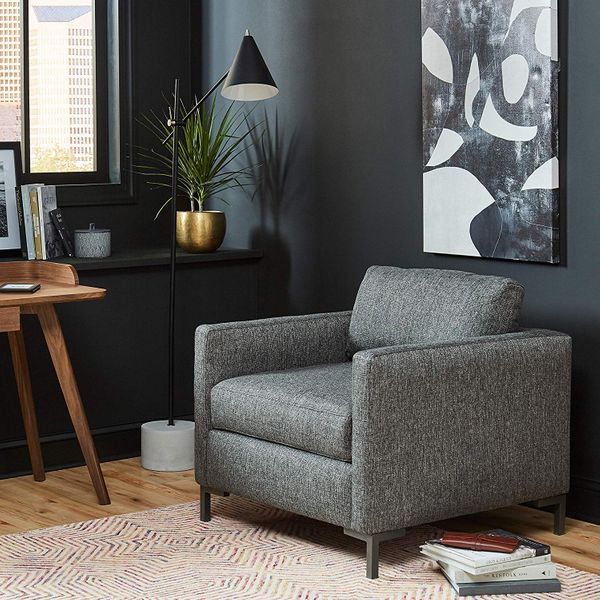 A Wayfair black steel floorlamp with silver accents on a white and grey marble base. The Strategist - Very Tasteful Lamps from Amazon's Rivet and Stone and Beam Are on Sale