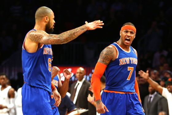 Carmelo Anthony #7 of the New York Knicks celebrates scoring a basket with Tyson Chandler #6 against the Brooklyn Nets during their game at the Barclays Center on December 11, 2012 in the Brooklyn borough of New York City.