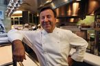 "Boulud in the kitchen at Daniel, which he considers ""home."""