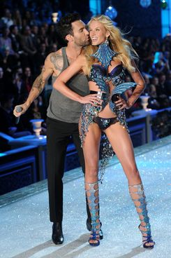 Adam Levine of Maroon 5 performs with Model Anne V during the 2011 Victoria's Secret Fashion Show at the Lexington Avenue Armory on November 9, 2011 in New York City.