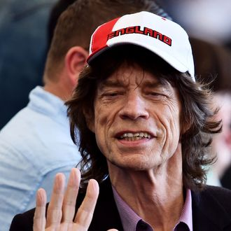 British musician Mick Jagger waves during a closing ceremony ahead of the final football match between Germany and Argentina for the FIFA World Cup at The Maracana Stadium in Rio de Janeiro on July 13, 2014. AFP PHOTO / GABRIEL BOUYS (Photo credit should read GABRIEL BOUYS/AFP/Getty Images)