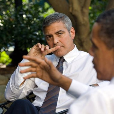 U.S. President Barack Obama (R) talks about Sudan with actor George Clooney during a meeting outside the Oval Office October 12, 2010 in Washington, DC.