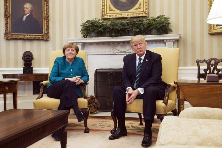 Trump Refuses to Shake Hands With Angela Merkel