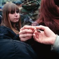 04 May 1996, New York City, New York State, USA --- A woman passes a joint at Hemp Fest '96/Cures Not Wars, a rally to legalize pot.