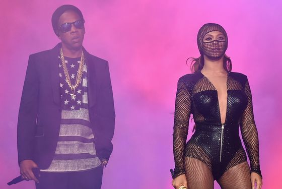 """CHICAGO, IL - JULY 24:  Jay-Z (L) and Beyonce perform onstage during the """"On The Run Tour: Beyonce And Jay-Z"""" at Soldier Field on July 24, 2014 in Chicago, Illinois.  (Photo by Larry Busacca/PW/WireImage for Parkwood Entertainment)"""