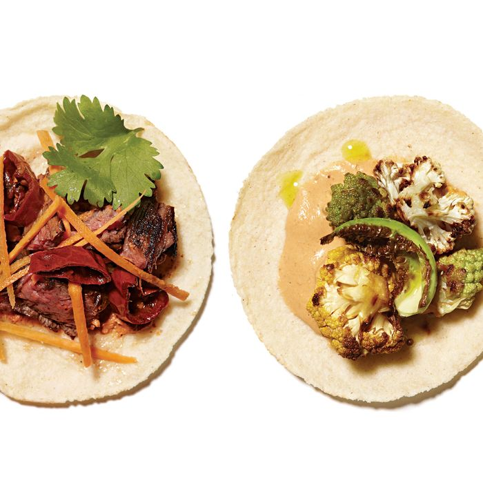 Skirt steak with pecan and chipotle at left; caulifower and curry crema taco on the right.