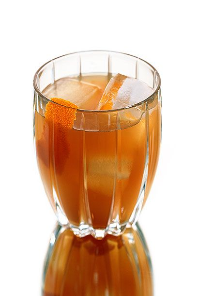 "<b>The Devotay</b>  <i><a href=""http://www.devotay.net/"">Devotay</a>, Iowa City</i>  Devotay owner Kurt Friese uses blood-orange liqueur to give this Manhattan variation its nice amber hue: In a mixing glass combine 1 3/4 ounces rye (the bar uses Templeton), 1/2 ounce <a href=""http://www.thatchersorganic.com/"">Thatcher's blood orange liqueur</a>, 1/2 ounce sweet vermouth, and 2 dashes Angostura bitters. Stir with ice for 40 rotations and strain into a chilled old-fashioned glass. Garnish with an orange twist."