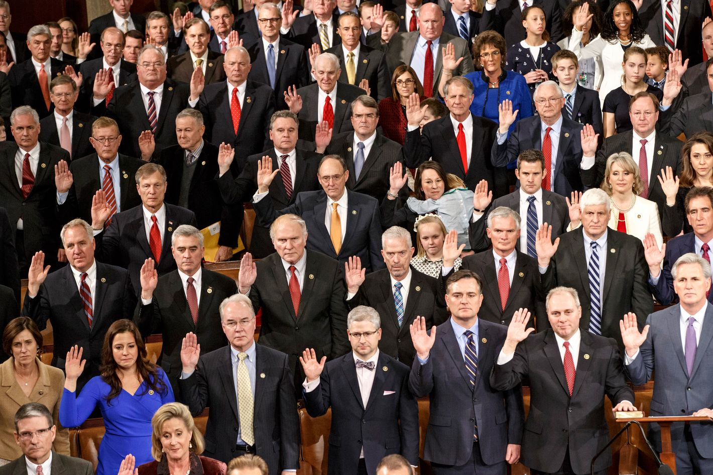 Members of the House of Representatives on the GOP side raise their hands for the oath of office at the opening session of the 114th Congress, Tuesday, Jan. 6, 2015, on Capitol Hill in Washington. House Speaker John Boehner of Ohio, won a third term despite a tea party-backed effort to unseat him.