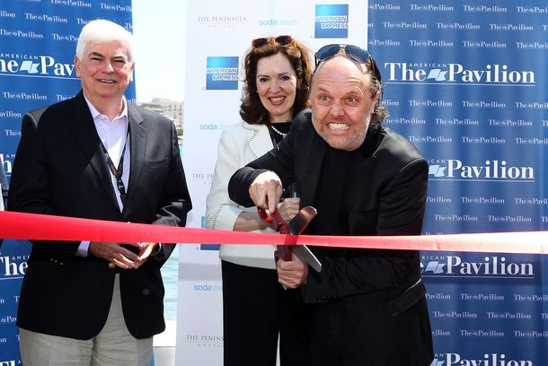 Lars Ulrich of Metallica cuts the ribbon to open the American Pavilion during the 66th Annual Cannes Film Festival at the American Pavilion on May 17, 2013 in Cannes, France.