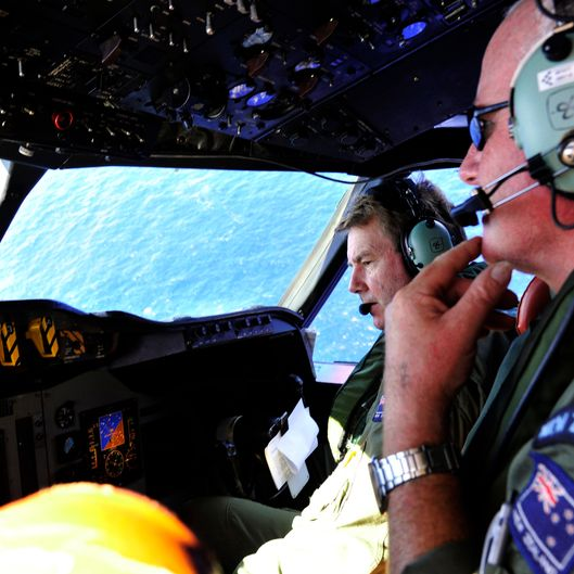 "AT SEA  - APRIL 11: Royal New Zealand Air Force (RNZAF) Co Pilot squadron Leader Brett McKenzie (L) and Flight Engineer Trent Wyatt sit in the cockpit aboard a P3 Orion maratime search aircraft as it flies over the southern Indian Ocean looking for debris from missing Malaysian Airlines flight MH370 on April 11, 2014 At Sea.  Search and rescue officials in Australia are confident they know the approximate position of the black box recorders from missing Malaysia Airlines Flight MH370, Australian Prime Minister Tony Abbott said on Friday. At the same time, however, the head of the agency coordinating the search said that the latest ""ping"" signal, which was captured by a listening device buoy on Thursday, was not related to the plane. (Photo by Richard Polden - Pool/Getty Images)"