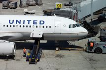 SAN FRANCISCO, CA - JULY 26:  Ground crews work on a United Airlines plane at San Francisco International Airport on July 26, 2012 in San Francisco, California. United Continental Holdings reported a 37 percent second quarter loss with earnings of $339 million or 89 cents a share compared to $538 million or $1.39 a share one year ago.  (Photo by Justin Sullivan/Getty Images)