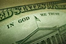 "A macro close up photo emphasizing the inscription ""In God We Trust"" printed on the back of an United States ten dollar bill with selective focus on the work God."