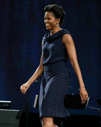 First lady Michelle Obama arrives to speak to people of diverse faiths during a gathering at Northland, A Church Distributed, Saturday, Feb. 11, 2012, in Longwood, Fla. The first lady spoke about the work of faith and community organizations to support healthy lifestyles during her three day national tour celebrating the second anniversary of Let's Move. (AP Photo/Carolyn Kaster)