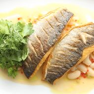 Roasted branzino with cannellini beans and herb salad.