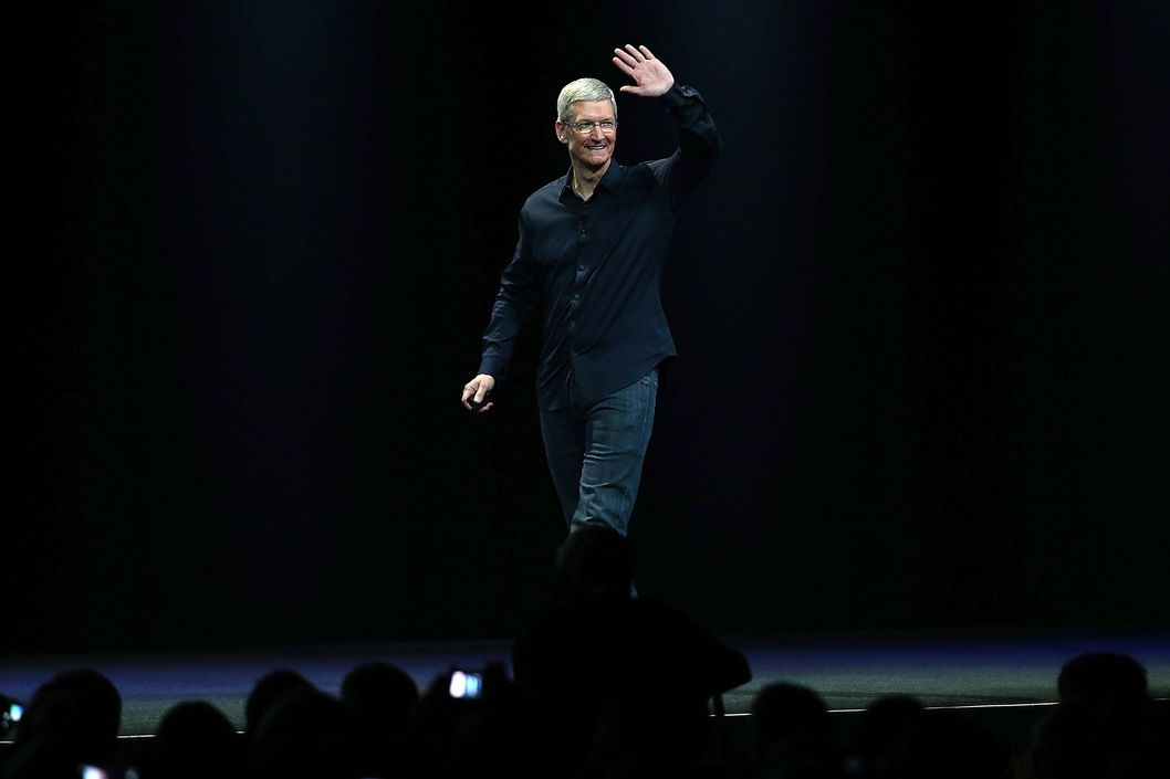 Apple CEO Tim Cook arrives to speak during the Apple Worldwide Developers Conference at the Moscone West center on June 2, 2014 in San Francisco, California. Tim Cook kicked off the annual WWDC which is typically a showcase for upcoming updates to Apple hardware and software. The conference runs through June 6.