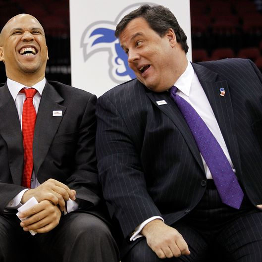 In this Jan. 25, 2011 file photo, Newark Mayor Cory Booker, left, jokes with New Jersey Governor Chris Christie during a news conference at the Prudential Center in Newark, N.J.