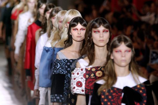 Models present creations by Italian designer Miuccia Prada for Miu Miu during the Spring/Summer 2012 ready-to-wear collection show, on October 5, 2011 in Paris. AFP PHOTO/PATRICK KOVARIK (Photo credit should read PATRICK KOVARIK/AFP/Getty Images)