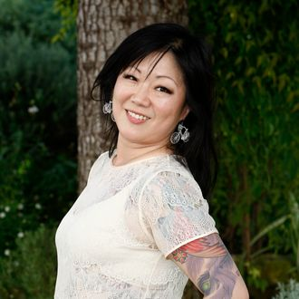 US fashion designer, actress, author, and recording artist Margaret Cho poses during a photocall to promote her new release