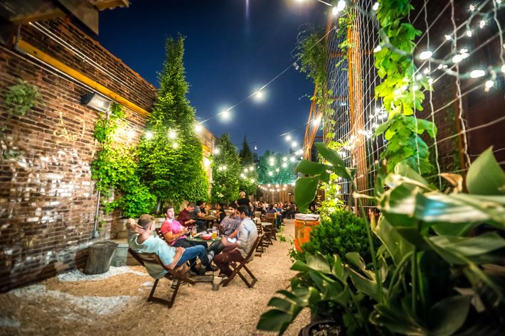 Twinkly Lights And Picnic Tables In The Backyard At Threes Brewing. Photo:  Noah Fecks
