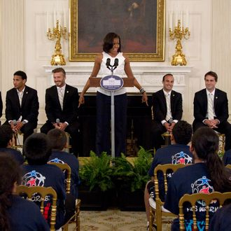 First lady Michelle Obama hosts a Let's Move! soccer event with students from across the country and the Major League Soccer champions LA Galaxy, Tuesday, May 15, 2012, in the State Dining Room of the White House in Washington. LA Galaxy players on the stage, from left are, Mike Magee, Sean Franklin, David Beckham, Landon Donovan, Todd Dunivant, A.J. DeLaGarza. (AP Photo/Carolyn Kaster)
