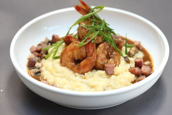 Shrimp and grits with mushrooms and Tasso ham.