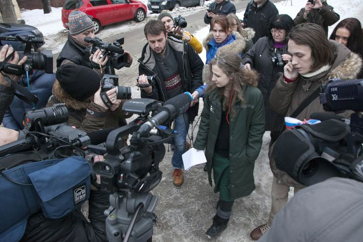 Maria Alyokhina, one of the jailed members of anti-Kremlin punk band Pussy Riot, is surrounded by journalists as she walks after beeing freed in Nizhny Novgorod on December 23, 2013. Alyokhina, who was freed from prison under a Kremlin-backed amnesty slammed the measure as a mere publicity stunt and said that she would have preferred to remain in prison.
