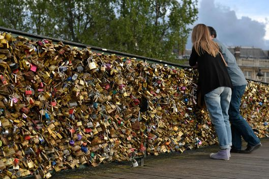 Love padlocks hang from the bridges over Seine River in the capital Paris, France on April 7, 2014.