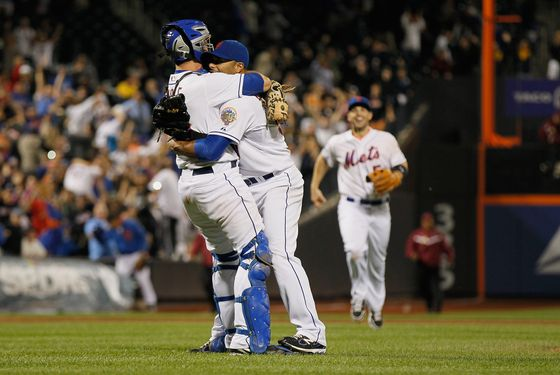 NEW YORK, NY - JUNE 01:  Johan Santana #57 of the New York Mets celebrates with Josh Thole #30 after pitching a no hitter against the St. Louis Cardinals at CitiField on June 1, 2012 in the Flushing neighborhood of the Queens borough of New York City. Johan Santana pitches the first no hitter in Mets history. The Mets won 8-0.  (Photo by Mike Stobe/Getty Images)