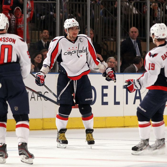 NEW YORK, NY - APRIL 30: Alex Ovechkin #8 of the Washington Capitals celebrates with teammates Marcus Johansson #90 and Nicklas Backstrom #19 after Ovechkin scored a goal to give the Capitals a 3-2 lead in the third period in Game Two of the Eastern Conference Semifinals during the 2012 NHL Stanley Cup Playoffs at Madison Square Garden on April 30, 2012 in New York City. (Photo by Bruce Bennett/Getty Images)