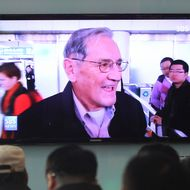 People watch a TV news program showing U.S. citizen Merrill Newman released by North Korea, at Seoul Railway Station in Seoul, South Korea, Saturday, Dec 7, 2013. North Korea on Saturday freed the 85-year-old U.S. veteran of the Korean War after a weekslong detention, ending the saga of Newman's attempt to visit the North as a tourist six decades after he oversaw a group of South Korean wartime guerrillas still loathed by Pyongyang. (AP Photo/Ahn Young-joon)