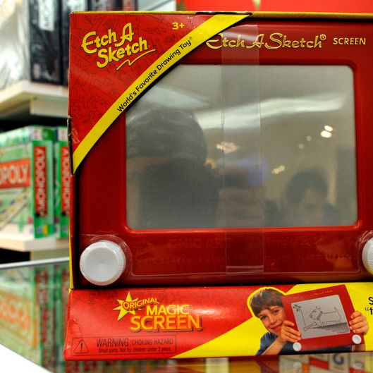 "An ""Etch A Sketch "" is for sale at FAO Schwarz in New York City on March 22, 2012. French electrician Andr? Cassagnes created the toy in the late 1950s as the ""L'Ecran Magique,"" and with the Ohio Art Company launched it in the US on July 12, 1960. The iconic toy has found its way to US presidential politics. Republican presidential hopeful Mitt Romney received backing from major Republican figures March 21 after a big win in Illinois, but an aide's gaffe reinforced qualms about his campaign. Asked on CNN whether the primary had pushed Romney too far to the right for general election voters, advisor Eric Fehrnstrom said ""I think you hit a reset button for the fall campaign. Everything changes."" ""It's almost like an Etch A Sketch. You can kind of shake it up and restart all over again."" AFP PHOTO / TIMOTHY A. CLARY (Photo credit should read TIMOTHY A. CLARY/AFP/Getty Images)"